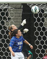 Boston College goalkeeper Alexandra Johnson (0) punches out a corner kick. Duke University defender Christina Gibbons (31).Boston College (white) defeated Duke University (blue/white), 4-1, at Newton Campus Field, on October 6, 2013.