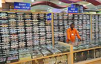 A shop keeper at the shirt counter at shirt shop in Madras, India