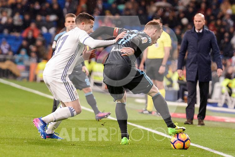 Real Madrid's Lucas Vazquez and Real Sociedad's David Zurutuza during La Liga match between Real Madrid and Real Sociedad at Santiago Bernabeu Stadium in Madrid, Spain. January 29, 2017. (ALTERPHOTOS/BorjaB.Hojas)