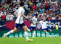 NASHVILLE, TN - SEPTEMBER 5: John Brooks #6 of the United States crosses the ball during a game between Canada and USMNT at Nissan Stadium on September 5, 2021 in Nashville, Tennessee.