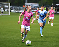 Kansas City, MO - Friday May 13, 2016: FC Kansas City defender Becky Sauerbrunn (4) and Chicago Red Stars forward Sofia Huerta (11)  during a regular season National Women's Soccer League (NWSL) match at Swope Soccer Village. The match ended 0-0.