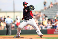 Minnesota Twins pitcher Lester Oliveros #17 delivers a pitch during a spring training game against the Pittsburgh Pirates at McKechnie Field on March 10, 2012 in Bradenton, Florida.  Minnesota defeated Pittsburgh 4-2.  (Mike Janes/Four Seam Images)