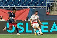 FOXBOROUGH, MA - AUGUST 21: Matt Bolduc #7 of Richmond Kickers passes the ball as Damian Rivera #72 of New England Revolution II closes during a game between Richmond Kickers and New England Revolution II at Gillette Stadium on August 21, 2020 in Foxborough, Massachusetts.