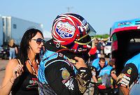 Apr. 29, 2011; Baytown, TX, USA: NHRA funny car driver Brian Thiel puts on his helmet with the help of wife Randi Thiel during qualifying for the Spring Nationals at Royal Purple Raceway. Mandatory Credit: Mark J. Rebilas-