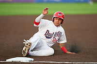Auburn Doubledays Wilmer Perez (20) slides safely into third base during a NY-Penn League game against the Connecticut Tigers on July 12, 2019 at Falcon Park in Auburn, New York.  Auburn defeated Connecticut 7-5.  (Mike Janes/Four Seam Images)