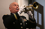 "Chief Warrant Officer Albert Pefley with the Nevada National Guard's joint color guard plays ""Taps"" during the opening ceremony of the Always Lost: A Meditation on War exhibit at the Legislative Building in Carson City, Nev., on Monday, April 6, 2015. <br />