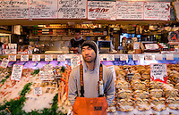 A worker waits for customers at Pike Place Market in Seattle Washington.