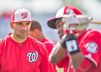 5 March 2016: Washington Nationals infielder Danny Espinosa listens to batting instruction from Manager Dusty Baker prior to a Spring Training pre-season game against the Detroit Tigers at Space Coast Stadium in Viera, Florida. The Nationals defeated the Tigers 8-4 in Grapefruit League play. Mandatory Credit: Ed Wolfstein Photo *** RAW (NEF) Image File Available ***