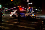 The NYPD investigates a crime scene, where 6 people were shot and one person killed at Franklin Avenue and  President Street early Wednesday morning on July 15, 2020 in the Crown Heights neighborhood in the Brooklyn Borough of New York City.  Photograph by Michael Nagle