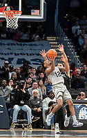 WASHINGTON, DC - FEBRUARY 19: Terrell Allen #12 of Georgetown and Luwane Pipkins #12 of Providence clash under the basket during a game between Providence and Georgetown at Capital One Arena on February 19, 2020 in Washington, DC.