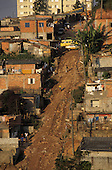 Sao Paulo, Brazil. High view of a shanty town street with unmade road and crudely built houses.