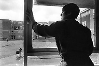 England. Greater Manchester. Salford. Women living in poverty. Lynn lives with her children (two teenagers) on social security contributions. She cleans the window of the Salford Women center. Salford is a city in the Metropolitan Borough of Salford in Greater Manchester. North West England is one of nine official regions of England. © 1990 Didier Ruef