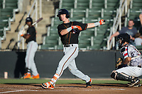 Chris Clare (9) of the Delmarva Shorebirds follows through on his swing against the Kannapolis Intimidators at Kannapolis Intimidators Stadium on June 30, 2017 in Kannapolis, North Carolina.  The Shorebirds defeated the Intimidators 6-4.  (Brian Westerholt/Four Seam Images)