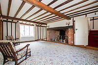 BNPS.co.uk (01202) 558833. <br /> Pic: Cheffins/BNPS<br /> <br /> Pictured: Sitting room. <br /> <br /> The perfect home for a recluse?<br /> <br /> A historic moated farmhouse that has not been sold for half a century is up for auction with a guide price of £600,000.<br /> <br /> Grade II listed Parsonage Farm is an English Heritage scheduled monument and is believed to be built on the site of an iron age fort.<br /> <br /> The house dates back to the 15th century and, having been in the same family for the past 50 years, is now in need of modernisation.<br /> <br /> But once renovated it could be worth £1.2m - double its current price tag.
