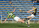Pearse Lillis of Ballyea in action against David Dooling of Glen Rovers during their Munster Club hurling final at Thurles. Photograph by John Kelly.