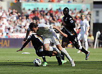 Pictured: Michu of Swansea is brought down by Eyong Enoh of Fulham. Sunday 19 May 2013<br /> Re: Barclay's Premier League, Swansea City FC v Fulham at the Liberty Stadium, south Wales.