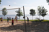 Volleyball played in the morning on the shore of Lake Chautauqua as part of the daily activities of the Boys and Girls Club. Chautauqua Institution, NY. June 27, 2014. Photo by Brendan Bannon.