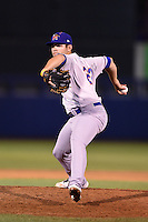 Midland RockHounds pitcher Tucker Healy (23) delivers a pitch during a game against the Tulsa Drillers on May 31, 2014 at ONEOK Field in Tulsa, Oklahoma.  Tulsa defeated Midland 5-3.  (Mike Janes/Four Seam Images)