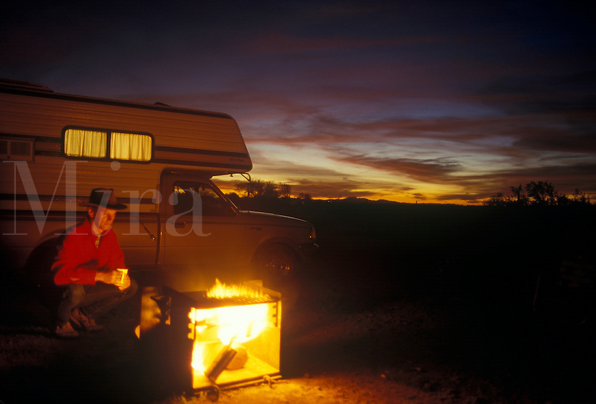 Camper sitting by campfire at Picacho Peak State Park Arizona