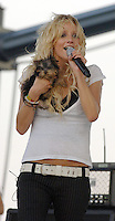 050606_MSFL_SMG<br /> <br /> WEST PALM BEACH, FL - MAY 06, 2006:  Ashlee Simpson with her new dog Hula rocks SunFest 2006. With her new dog, new blonde extensions, along with a  brand new nose (Early on April 21, a source says, Ashlee, 21, arrived at the office of famed Beverly Hills plastic surgeon Dr. Raj Kanodia with her parents, Joe and Tina, for a nose job) It seems younger sis Ashlee's recent nose job makes her look more like her big sis, Jessica. It's the latest move in a makeover that's seen Ashlee go from dark-haired, ratty rocker to sophisticated blonde. Apparently not everyone is happy with Ashlee's new look. It has been reported that Jessica, 25, is furious over Ashlee's apparent quest to morph into her more successful sis. <br /> <br /> Ashlee requested that there be no photography at her stage (perhaps to hide her new nose till it fully heals) but that did not keep her fans from capturing her new nose and her new look on film anyway. She looked absolutely radiant at the show as she performed with her new boyfriend, guitar player Braxton Olita. West Palm Beach, Florida. (Photo by Storms Media Group)<br /> <br /> People;  Hula; Ashlee Simpson<br /> <br /> Must call if interested <br /> Michael Storms<br /> Storms Media Group<br /> 305-632-3400<br /> MikeStorm@aol.com