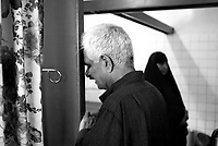 Baghdad, Iraq, April 5, 2003.Al Kindi hospital emergency ward: Daoud Al Jenabi, 52, prays for the life of his son Daoud Al Jenabi, 19, wounded in the chest in front of his home at Zayuna by a US bomb. More than 70 US bombardment victims were admitted in less than 2 hours after a B52 carpet bombing on the Northern outskirts, about a fifth of these were military personel.