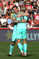 Leandro Trossard of Brighton & Hove Albion celebrates scoring their only goal of the match with Lewis Dunk during Brentford vs Brighton & Hove Albion, Premier League Football at the Brentford Community Stadium on 11th September 2021
