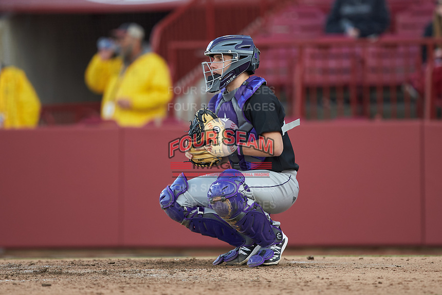 Holy Cross Crusaders catcher Angelo D'Acunto (10) warms up the pitcher between innings of the game against the South Carolina Gamecocks at Founders Park on February 15, 2020 in Columbia, South Carolina. The Gamecocks defeated the Crusaders 9-4.  (Brian Westerholt/Four Seam Images)