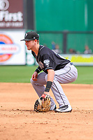 Lansing Lugnuts first baseman Christian Williams (24) gets in defensive position during a Midwest League game against the Wisconsin Timber Rattlers on May 8, 2018 at Fox Cities Stadium in Appleton, Wisconsin. Lansing defeated Wisconsin 11-4. (Brad Krause/Four Seam Images)