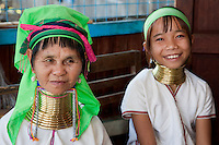 Myanmar, Burma.  Padaung Women with Brass Neck Coils, Inle Lake, Shan State.  The Padaung are also called Kayan Lahwi.