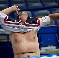 29-01-2014,Czech Republic, Ostrava,  Cez Arena, Davis-cup Czech Republic vs Netherlands, practice,Coach  Raymond Knaap (NED)changing shirts<br /> Photo: Henk Koster