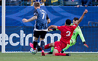 CARSON, CA - FEBRUARY 15: Aleksander Katai #7 of the Los Angeles Galaxy attempts a shot past GK Quentin Westberg #16 and Justin Morrow #2 of Toronto FC during a game between Toronto FC and Los Angeles Galaxy at Dignity Health Sports Park on February 15, 2020 in Carson, California.