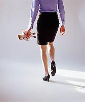 Woman walking away with Raggedy Ann doll<br />