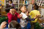 Education Preschool 4 year olds music dancing activity group of children moving and enjoying themselves