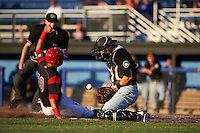 West Virginia Black Bears catcher Arden Pabst (52) fields a throw as J.J. Gould (49) scores a run with umpire Louie Krupa looking on to make the call during a game against the Batavia Muckdogs on June 29, 2016 at Dwyer Stadium in Batavia, New York.  West Virginia defeated Batavia 9-4.  (Mike Janes/Four Seam Images)