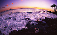 Milky waves crash on the volcanic beach as the sun sets at the Outrigger Palms Hotel resort in Wailea, Maui, Hawaii, August 7, 2001.