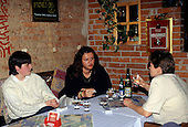 Ostrava, Czech Republic. Three women having a drink in a restaurant, one smoking.