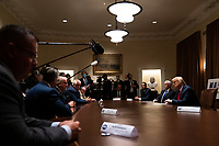 United States President Donald J. Trump, right, participates in a meeting with members of the National Association of Police Organizations Leadership in the Cabinet Room of the White House in Washington, DC, on July 31st, 2020.<br /> Credit: Anna Moneymaker / Pool via CNP /MediaPunch
