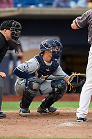 West Michigan Whitecaps catcher Christopher Proctor (7) waits to receive a pitch in front of home plate umpire Jake Botek during a game against the Quad Cities River Bandits on July 22, 2018 at Modern Woodmen Park in Davenport, Iowa.  West Michigan defeated Quad Cities 6-4.  (Mike Janes/Four Seam Images)