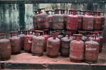 Cooking gas cylinders are stacked on a footpath before being despatched to customers during 21 days lock down in India due to covid 19 pandemic. Kolkata, West Bengal, India. Arindam Mukherjee.
