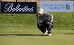 JEJU, SOUTH KOREA - APRIL 23:  Tano Goya of Argentina lines up a putt on the 18th green during the Round Two of the Ballantine's Championship at Pinx Golf Club on April 23, 2010 in Jeju island, South Korea. Photo by Victor Fraile / The Power of Sport Images