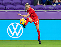 ORLANDO, FL - FEBRUARY 21: Gabrielle Carle #14 of Canada crosses the ball during a game between Canada and Argentina at Exploria Stadium on February 21, 2021 in Orlando, Florida.