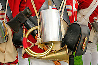 Equipment of bugler of His Majesty's 10th Regiment of Foot, during re-actment of 1775 Siege of Boston, Boston Common, includes bugle, tin canteen, axe and black leather ammunition box adorned with brass regimental number and king's crown, Boston, Massachusetts, USA.