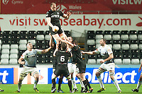 Friday 21 March 2014<br /> Pictured: Ospreys captain Alun Wyn Jones Jumps for a line out ball<br /> Re: Rabo Direct PRO12 Match Ospreys vs Cardiff Blues at the Liberty Stadium, Swansea, Wales