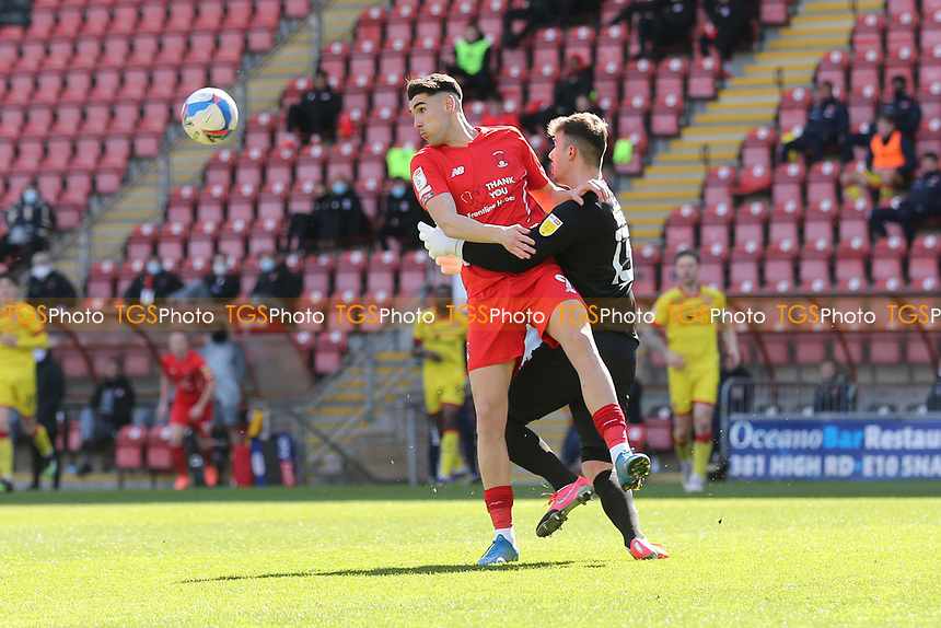 Conor Wilkinson of Leyton Orient tangles with Jack Rose of Walsall during Leyton Orient vs Walsall, Sky Bet EFL League 2 Football at The Breyer Group Stadium on 5th April 2021