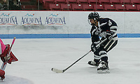Boston, Massachusetts - February 13, 2016: NCAA Division I. Boston University (pink)) defeated University of New Hampshire (blue), 6-4, at Walter Brown Arena. <br /> University of New Hampshire forward Jonna Curtis (6) scoring effort.