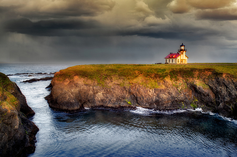 Point Cabrillo Lighthouse with sunrise and bay. California