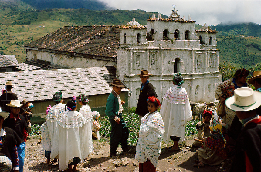 Colonial church of San Mateo Ixtatan, Cuchumatanes Mountains, Guatemala. The women in foreground wear the typical dress of a neighboring village.