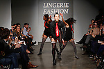 Performers dance on runway during the Lingerie Fashion Week Fall 2014 closing show on February 22, 2014.