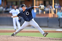 Charleston RiverDogs relief pitcher Keegan Curtis (11) delivers a pitch during a game against the Asheville Tourists at McCormick Field on August 16, 2019 in Asheville, North Carolina. The Tourists defeated the RiverDogs 12-3. (Tony Farlow/Four Seam Images)