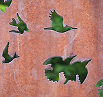 Metal artwork with bird shaped openings on UM campus in Missoula, Montana
